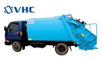 xe thu gom rác trên đường